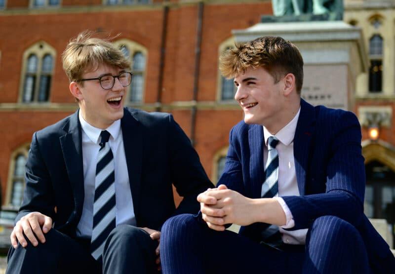 Two Senior school pupils laughing